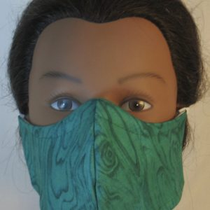 Face Mask in Green on Turquoise Green Wood - front