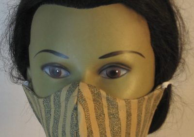 Face Mask in Tan with Dotted Waves of Black Dots - front