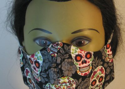 Face Mask in Pink Green Yellow Sugar Skulls Gray Flowers on Black - front
