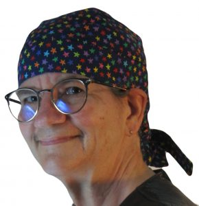 Hair Bag in Primary Rainbow Stars on Navy - model white