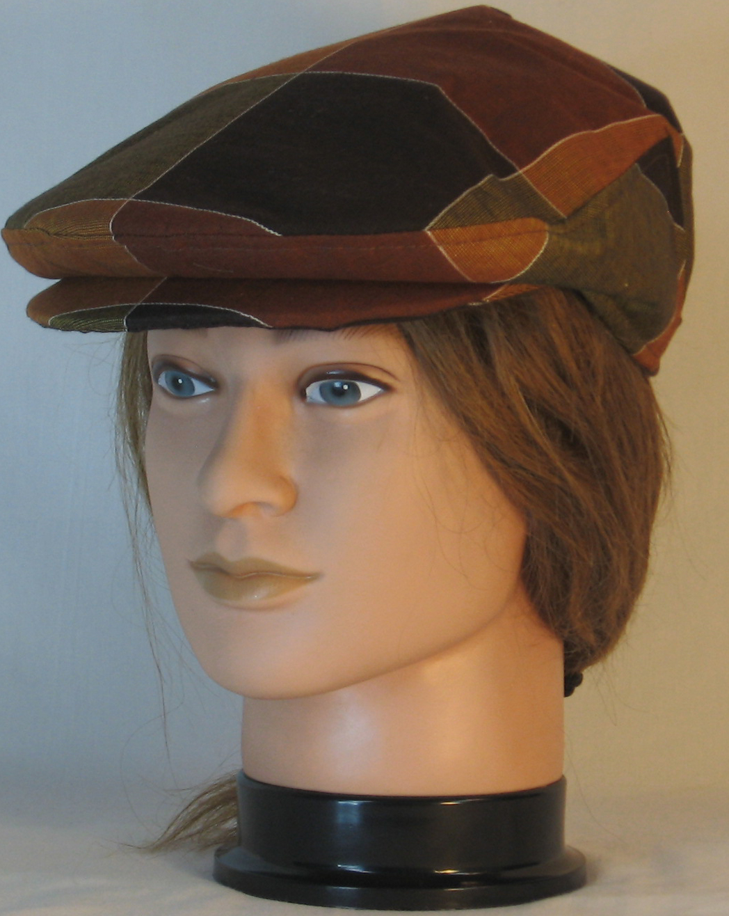 Ivy Flat Cap in large squares in brown golden yellow Plaid Shirting - front left