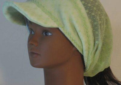 Slouchy Beanie in Small Flower Dot Green Lace on White Fleece - front left