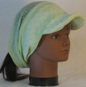 Slouchy Beanie in Small Flower Dot Green Lace on White Fleece - front right
