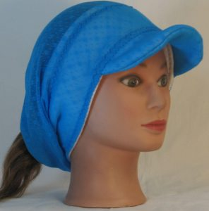 Slouchy Beanie in Small Flower Dot Turquoise Lace on White Fleece - front right