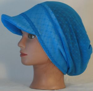 Slouchy Beanie in Small Flower Dot Turquoise Lace on White Fleece - right hair