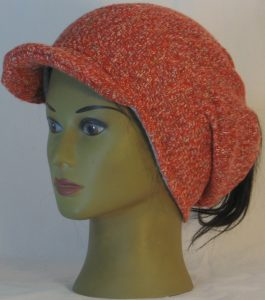 Slouchy Beanie in Orange with Green Blue Gray Sweater Knit - front left