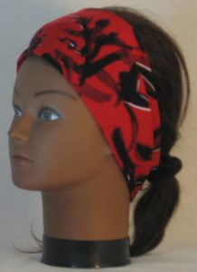 Headband in Black with White Leave Branch Marks on Red - left