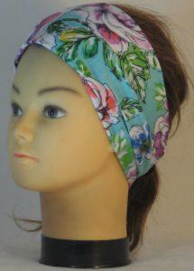 Headband in Orange Blue Purple Flowers on Turquoise - left