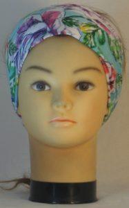 Headband in Orange Blue Purple Flowers on Turquoise - front