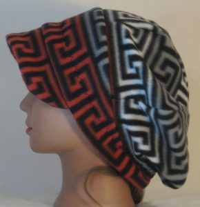 Newsboy in Red Black and White Black Gray Squared Spiral - left