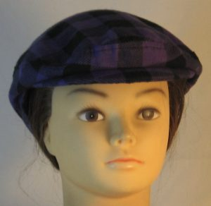 Ivy Flat Cap in Purple Black Big Check Flannel - front