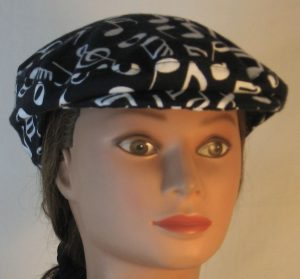 Ivy Flat Cap in White Music Notes Clef Signs on Black Flannel - front