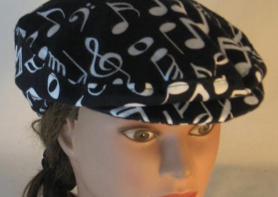 Ivy Flat Cap in White Music Notes Clef Signs on Black Flannel - top
