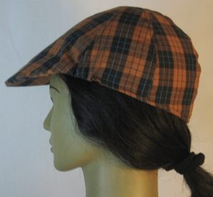 Duckbill Flat Cap in Orange Black Check with Blue Grid Plaid Shirting - left