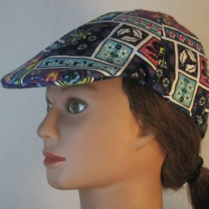 Duckbill Flat Cap in Blocks with Leaves Flowers on White Flannel - left