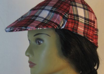 Duckbill Flat Cap in Red White Black Plaid with White Rectangle Flannel - left