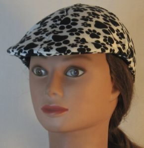 Duckbill Flat Cap in Black Paws on White Flannel - front