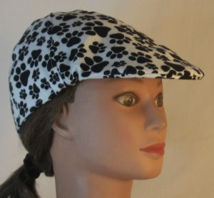 Duckbill Flat Cap in Black Paws on White Flannel - right