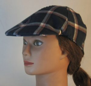 Duckbill Flat Cap in Aegean Blue Grid Plaid with Peach White Navy Flannel - front left