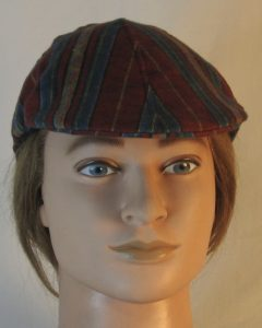 Duckbill Flat Cap in Diamond in Yellow Stripe of Red Blue Green Southwestern Shirting - front