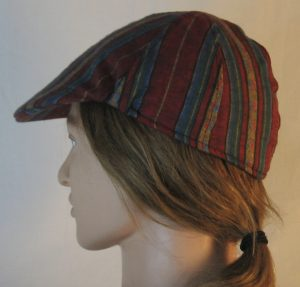 Duckbill Flat Cap in Diamond in Yellow Stripe of Red Blue Green Southwestern Shirting - left
