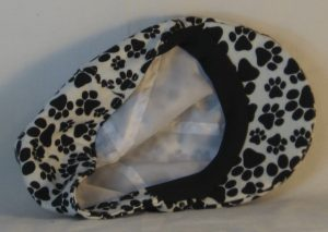 Duckbill Flat Cap in Black Paws on White Flannel - inside
