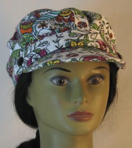 Fisherman Cap in Purple Yellow Green Flowers Paisley Balls Outlined in Black on White Flannel - front