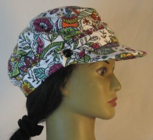 Fisherman Cap in Purple Yellow Green Flowers Paisley Balls Outlined in Black on White Flannel - right