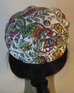 Fisherman Cap in Purple Yellow Green Flowers Paisley Balls Outlined in Black on White Flannel - back