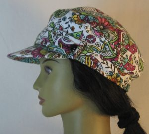 Fisherman Cap in Purple Yellow Green Flowers Paisley Balls Outlined in Black on White Flannel - left