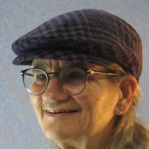 Flat Cap in Purple Black Plaid Houndstooth Wool - model