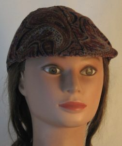 Duckbill Flat Cap in Blue Burgundy Peach Paisley Curves on Tan Corduroy - front