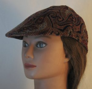 Duckbill Flat Cap in Blue Burgundy Peach Paisley Curves on Tan Corduroy - front left