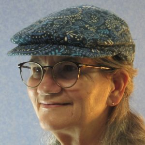 Flat Cap in Blue Flowered Paisley Flannel-model