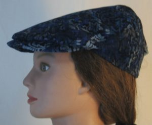 Ivy Flat Cap in Blue Black Flower Corduroy - left