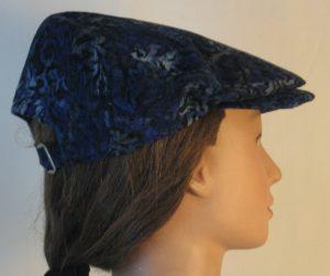 Ivy Flat Cap in Blue Black Flower Corduroy - right back
