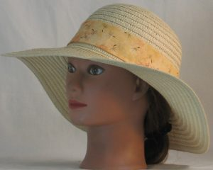 Floppy Hat Band in Dandelion Seeds on Peach - front left