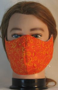 Face Mask in Red Yellow Paisley Springs on Orange - front