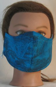 Face Mask in Turquoise with Sun Clouds in Black Lines - front