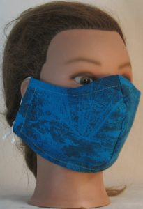 Face Mask in Turquoise with Sun Clouds in Black Lines - front right