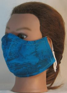 Face Mask in Turquoise with Sun Clouds in Black Lines - front left