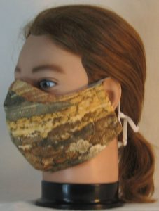 Face Mask in Landscape Mountain Trees in Tan - front left