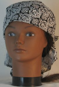 Head Wrap in White Leaf Scroll Medallion on Black with White Ties - front